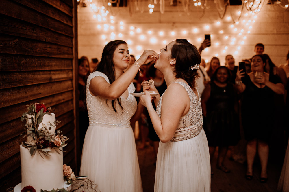 Brides Eating Wedding Cake at their Wedding at Terrain in Glenn Mills