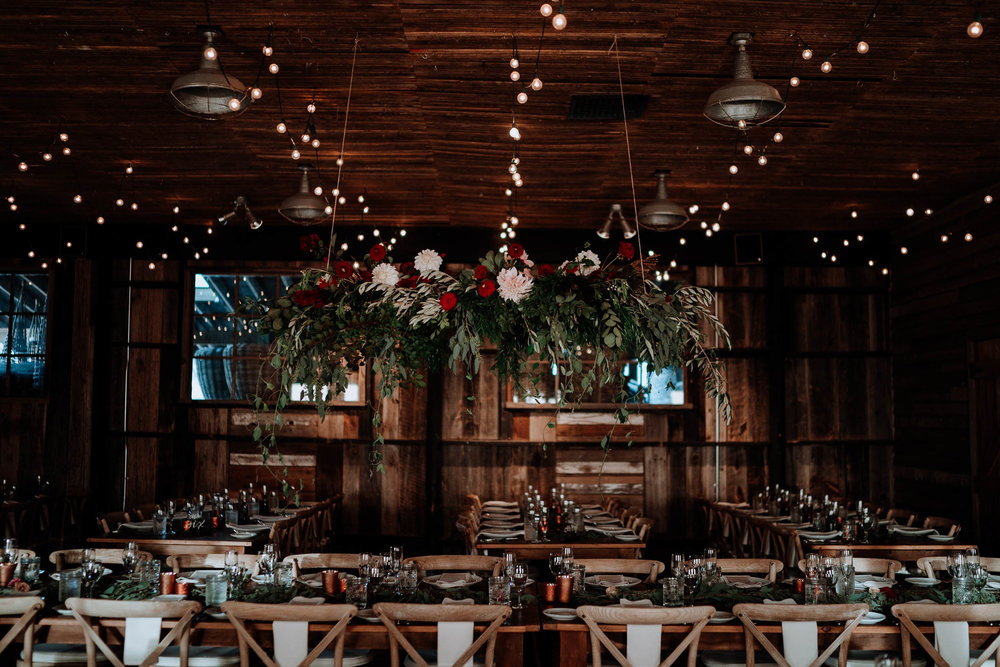 Hanging flower installation over reception tables at Terrain
