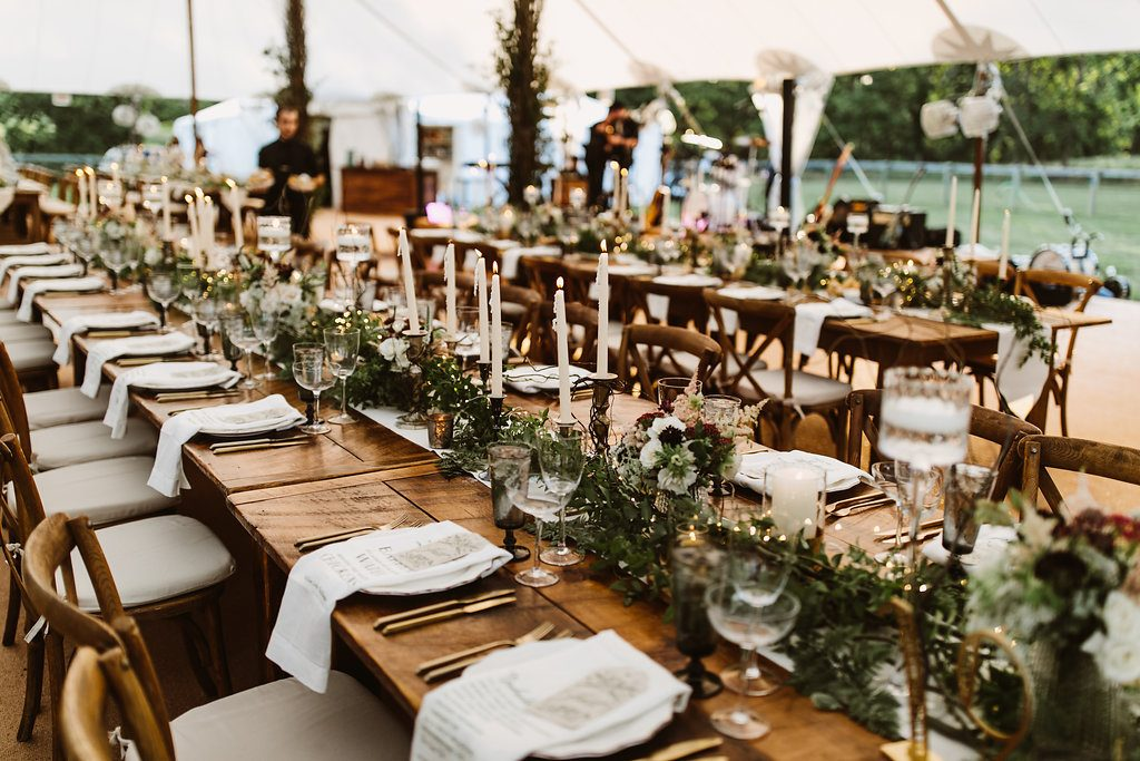 Barn table wedding table with greenery centerpieces