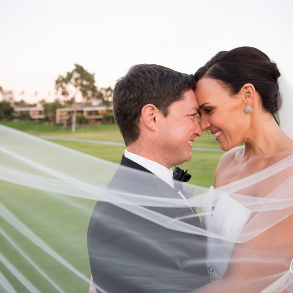48_just-married-couple-bride-groom-veil-Newport-Beach-Country-Club-wedding-photo