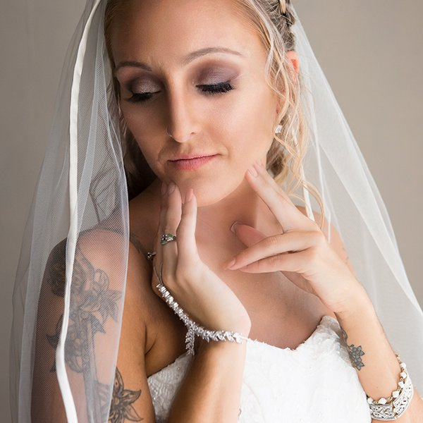 Portrait of a bride using natural light by the window, taken at La Mirage in Ulster Park NY.