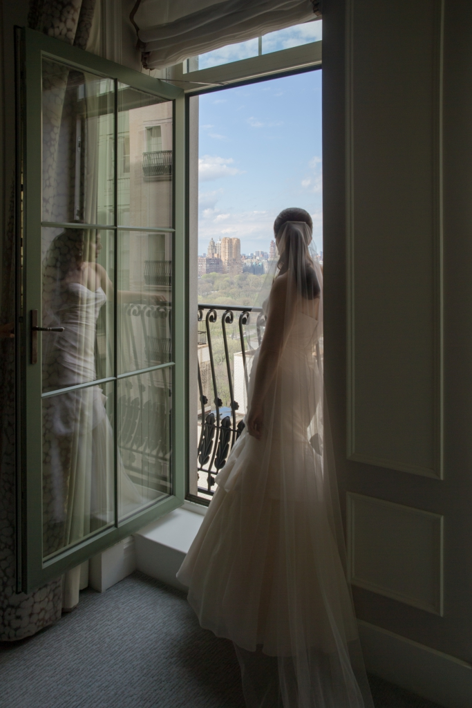 plaza hotel room window wedding bridal portrait