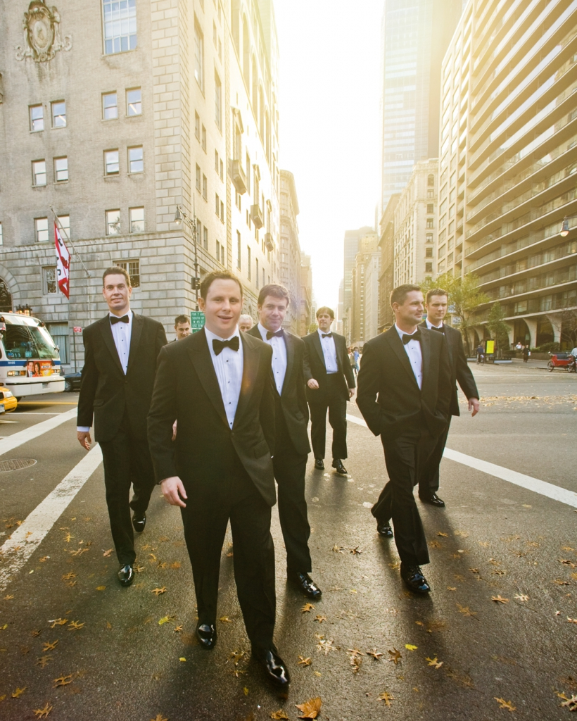 new york groomsmen crossing 59th st to central park wedding