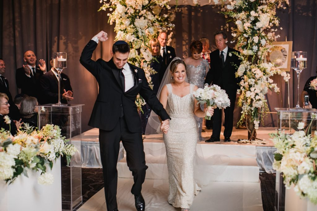 ivy and matt walk down the aisle after saying i do