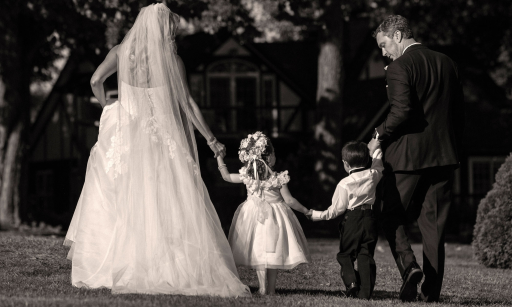 bride and groom with kids