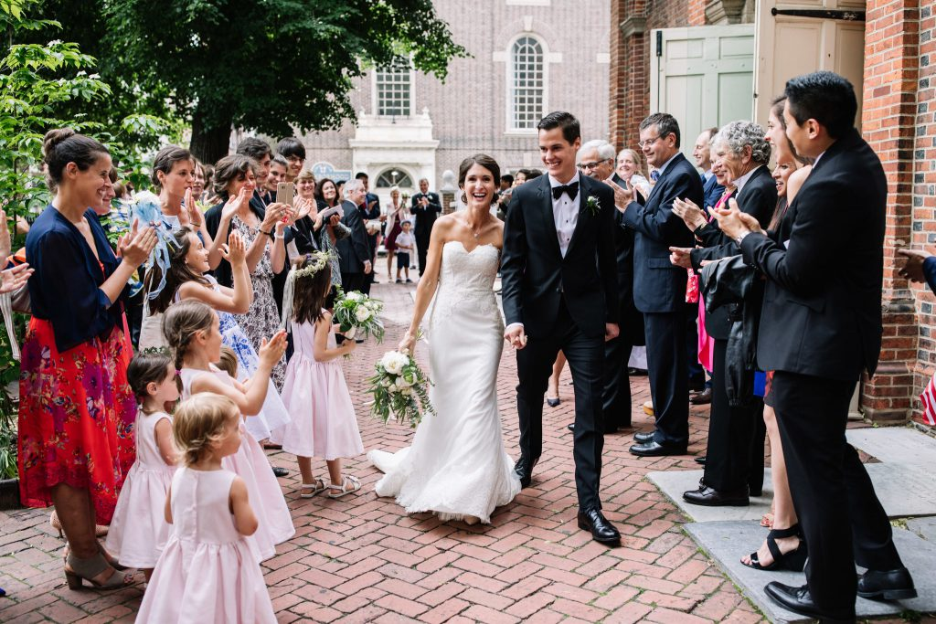 Just Married couple exits Christ Church in Philadelphia as they head to their wedding at the Horticulture Center