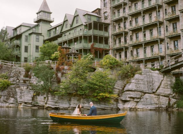 Bride and Groom steal time away in rowboat at Mohonk Mountain House Wedding