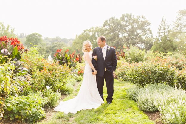 Bride and groom in gardens at summer wedding at Morris Arboretum