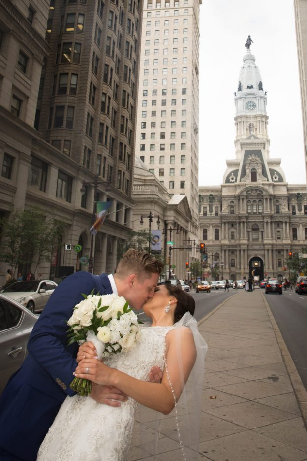 Bride and Groom kiss on Broad Street during their Ballroom at the Ben wedding