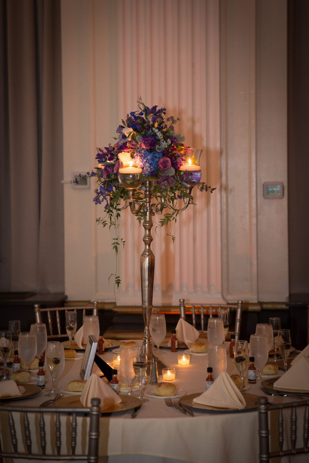Blue and purple tall candelabra centerpiece Ballroom at the Ben wedding