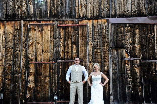 Bride and groom in front of barn at Burnside Plantation Wedding