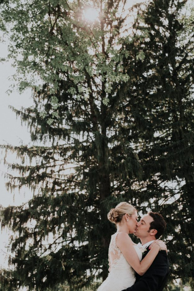 Bride and Groom kiss at Wilmington Country Club Wedding