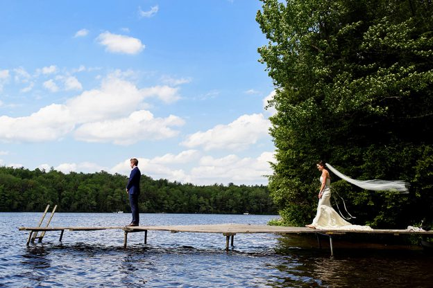 First look on dock at Pocono Lake Preserve Wedding