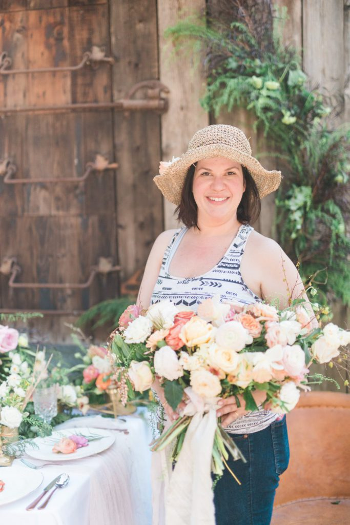 Becky of RAM Floral with huge bouquet of garden roses with silk ribbon