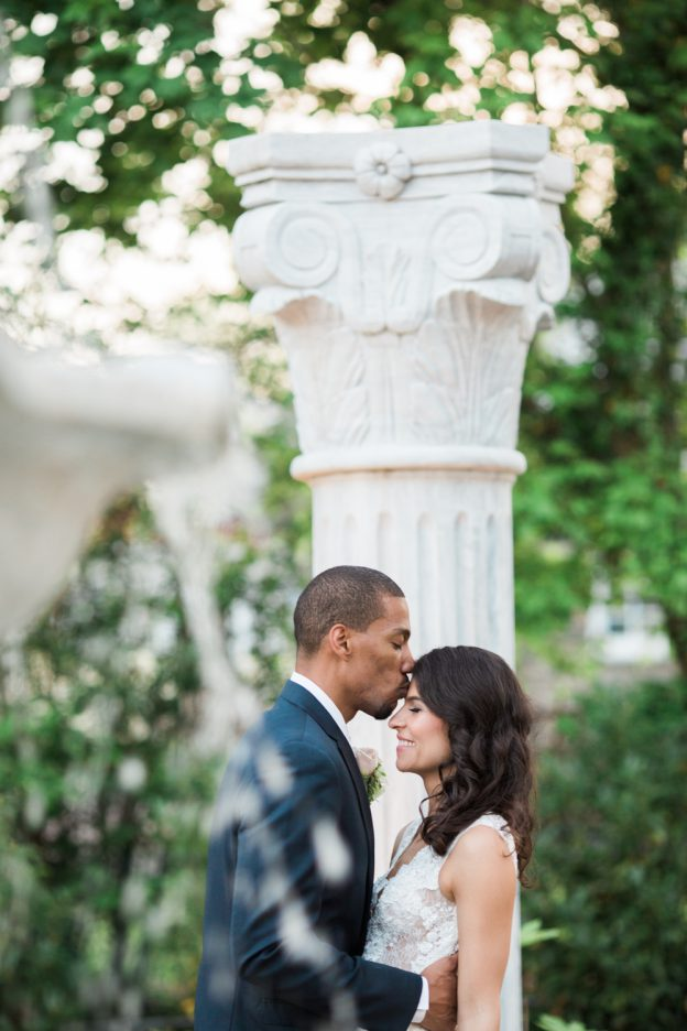 Groom kissed bride in the gardens at Waterfall wedding
