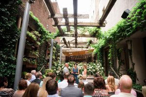 Wedding at Talula's Garden with Ceremony in the greenery and flower filled courtyard