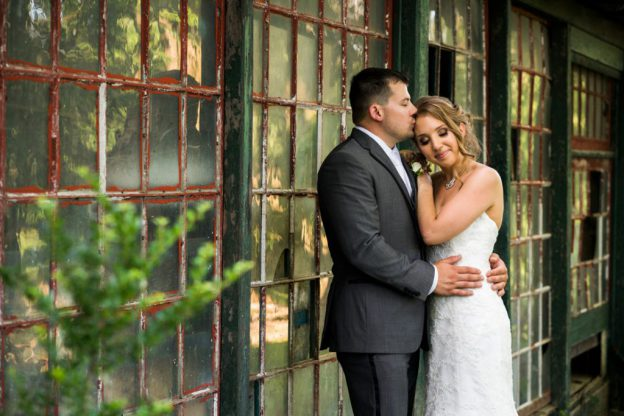 Couple in front of wall of windows at Knowlton Mansion Wedding