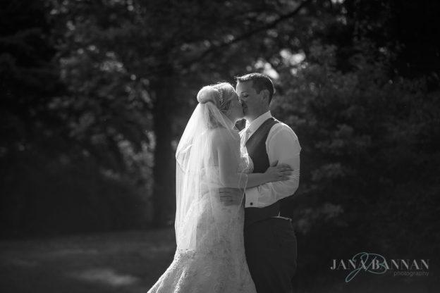 Newlyweds kiss at Mendenhall Inn Wedding