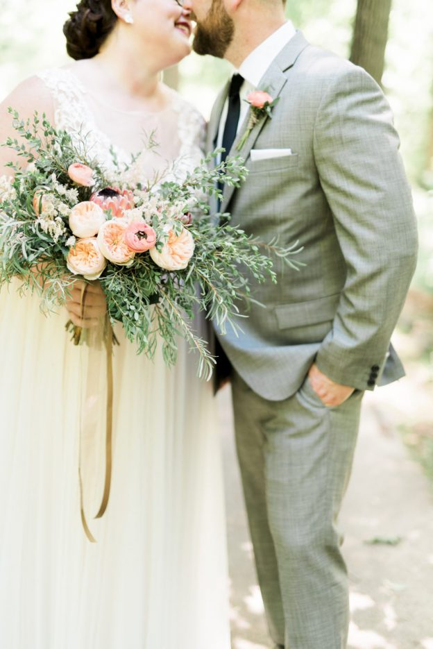 Couple holding stunning bouquet at West Chester Wedding