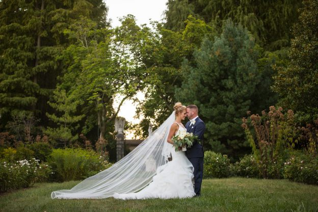 Bride with cathedral veil and groom at wedding at Deerfield
