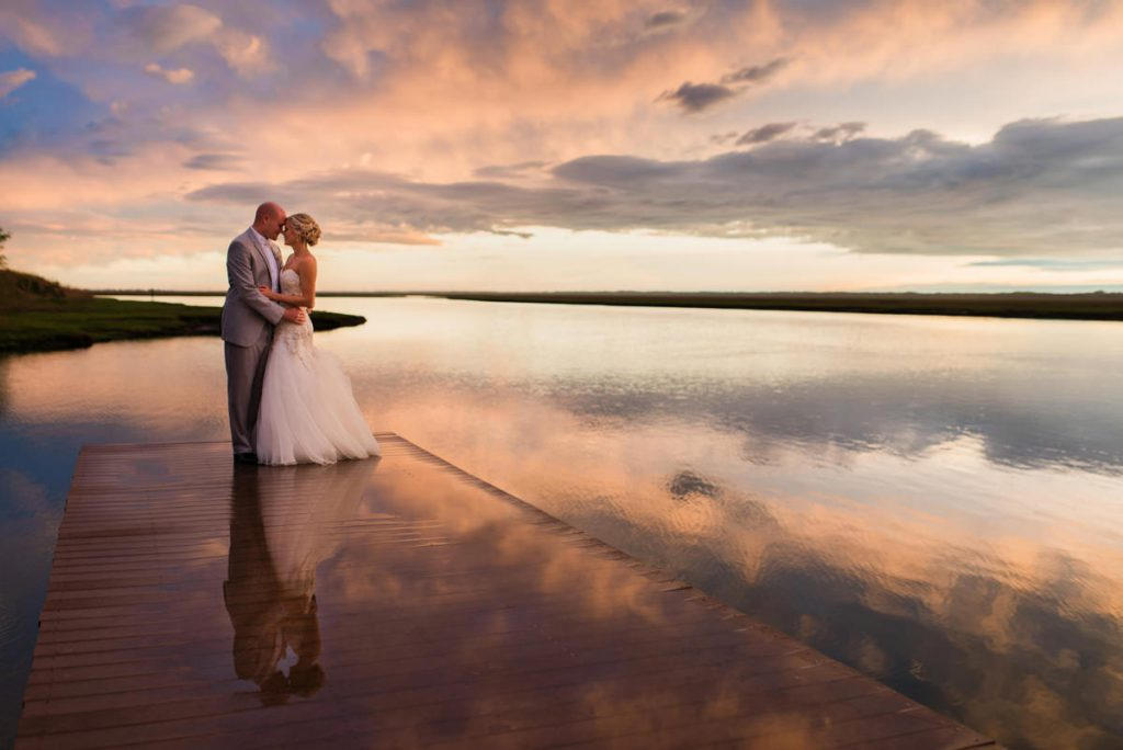 Bride and groom on the beach at their Yacht Club of Sea Isle Wedding