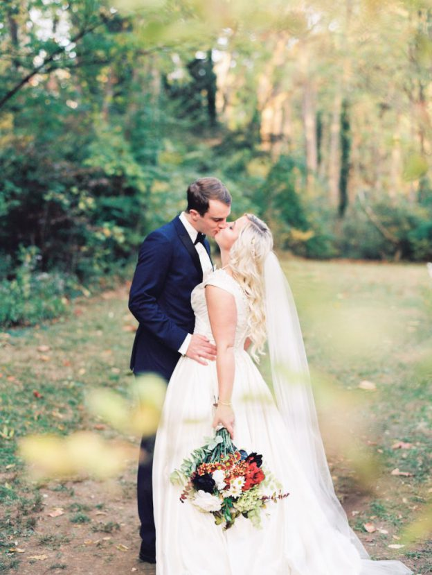 Bride and groom kiss at their wedding at The Old Mill