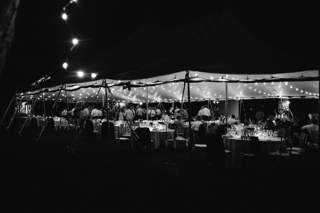 Outdoor Tent Wedding at Paxson Hill Farm with Edison Lights. Photo by Du Soleil Photographie.