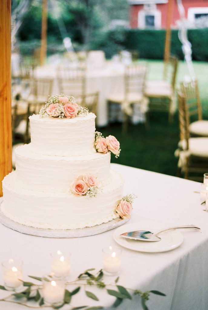Classic White Tiered Wedding Cake with Pink Roses and Baby's Breath
