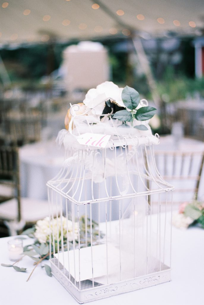 White bird cage card holder for wedding. Photo by Du Soleil Photographie.