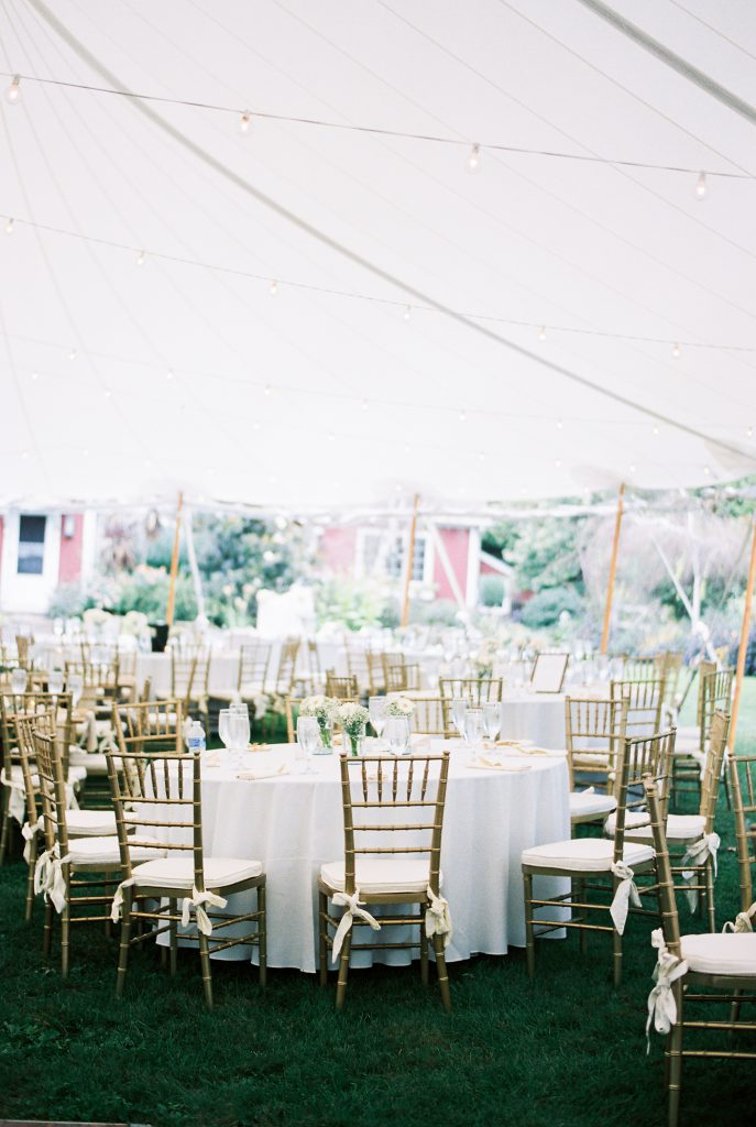 Outdoor Tent Wedding at Paxson Hill Farm with an English Garden Theme with bistro lights and gold garden chairs. Photo by Du Soleil Photographie.