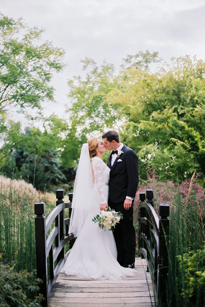 Bride and Groom on bridge at Paxson Hill Farm during Summer wedding. Photo by Du Soleil Photographie.