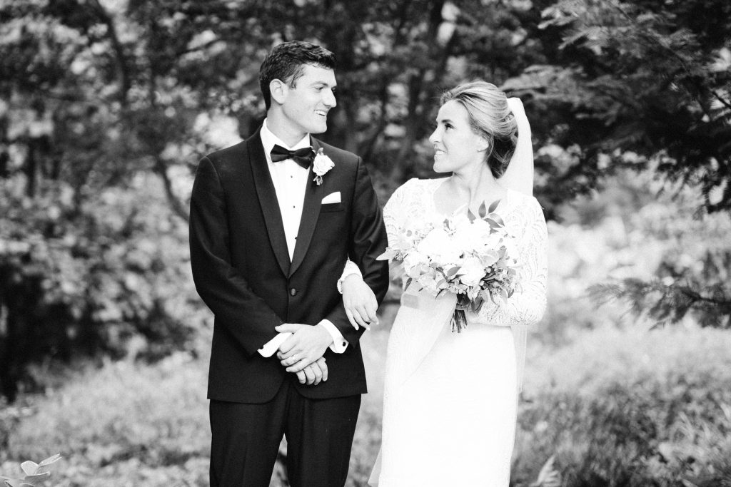 Bride and Groom wedding portrait at Paxson Hill Farm. Groom in formal black tuxedo and bride in long sleeve lace wedding dress. Photo by Du Soleil Photographie.