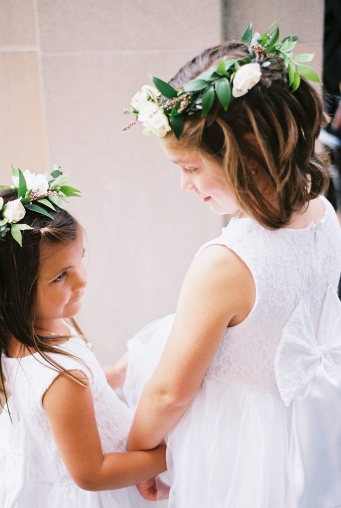 White and green flower girl crowns by Marrazo's Manor Lane Florist. Photo by Du Soleil Photographie.