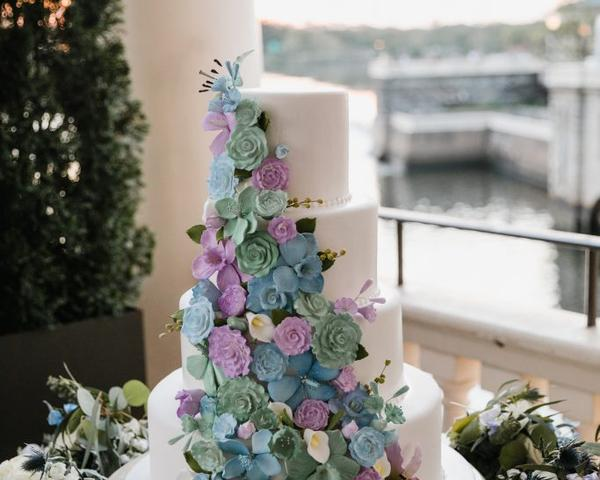 Wedding Cake with Purple, Green, and Blue Sugar Flowers by Cescaphe Event Group. Photo by Love Me Do Photography.