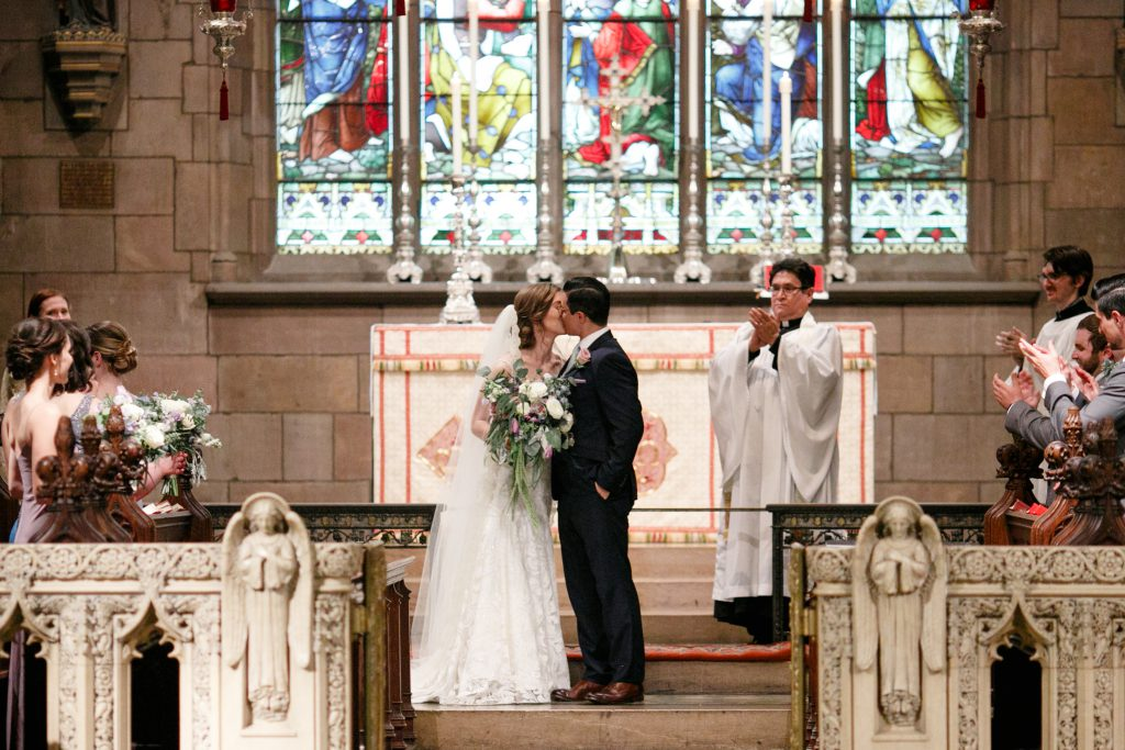 Bride and Groom kiss on alter of St. Mark's Episcopal Church in Center City Philadelphia. Photo by Love Me Do Photography.
