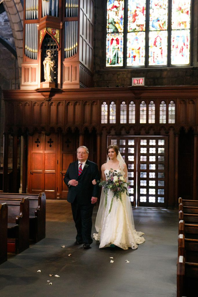 Bride's entrance for wedding at St. Mark's Episcopal Church in Center City Philadelphia. Bridal bouquet by Robertson's Flowers & Designs and photo by Love Me Do Photography.