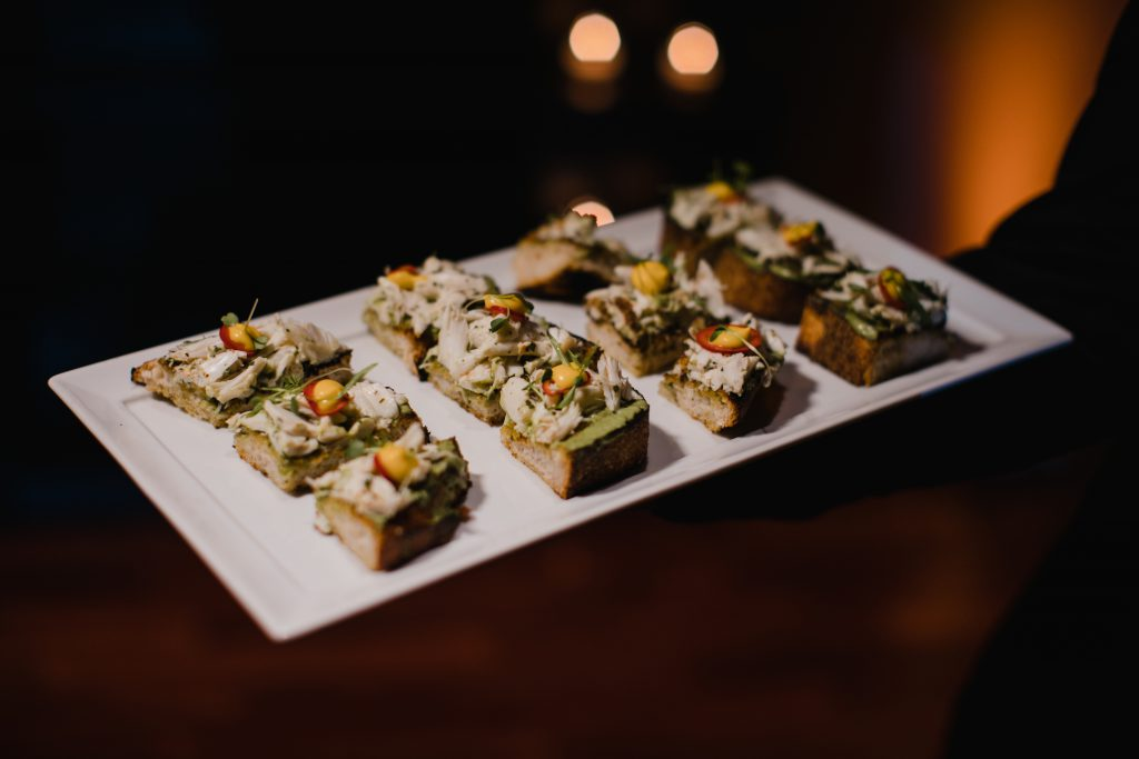 Cocktail hour appetizers for wedding reception at The Olde Bar in Philadelphia. Food by The Olde Bar, a Garces Events Restaurant. Photo by Love Me Do Photography.