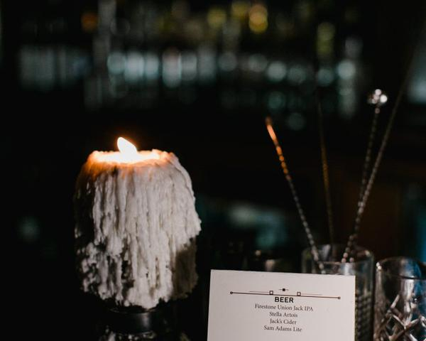 Signature cocktail menu for wedding reception at The Olde Bar Philadelphia, a Garces Events Restaurant. Photo by Love Me Do Photography.