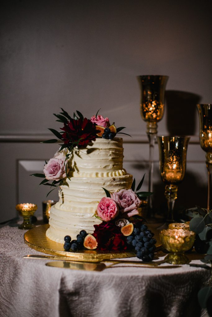 Fall Wedding Cake with buttercream frosting and fresh fruit and flowers by Baked Pastry Shop in Philadelphia. Photo by Love Me Do Photography.