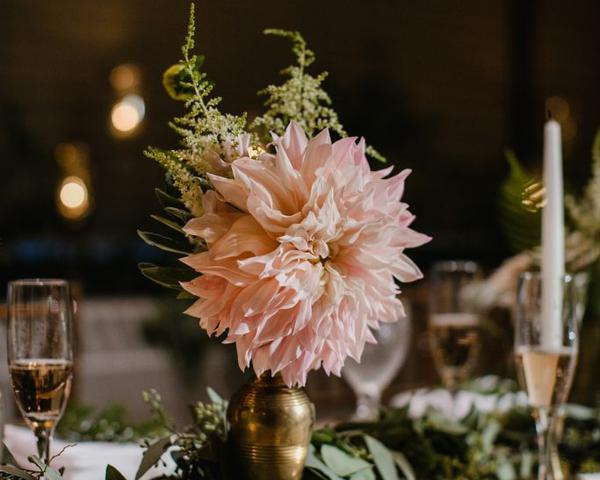 Wedding centerpiece with brass vase and pink wedding flowers by A Garden Pary at The Olde Bar. Photo by Love Me Do Photography.