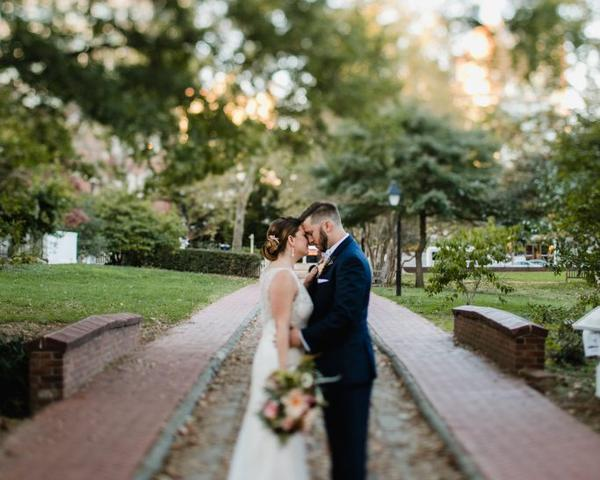 Bride and Groom in 18th Century Garden for wedding photos by Love Me Do Photography in Fall.