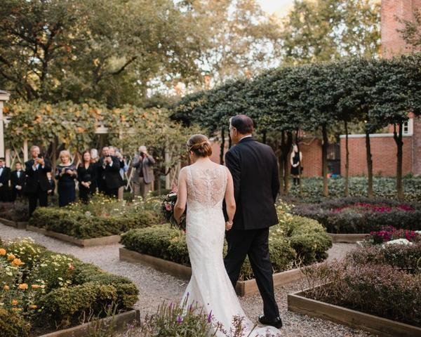 Bride walks down aisle for 18th Century Garden wedding in Philadelphia. Photo by Love Me Do Photography.