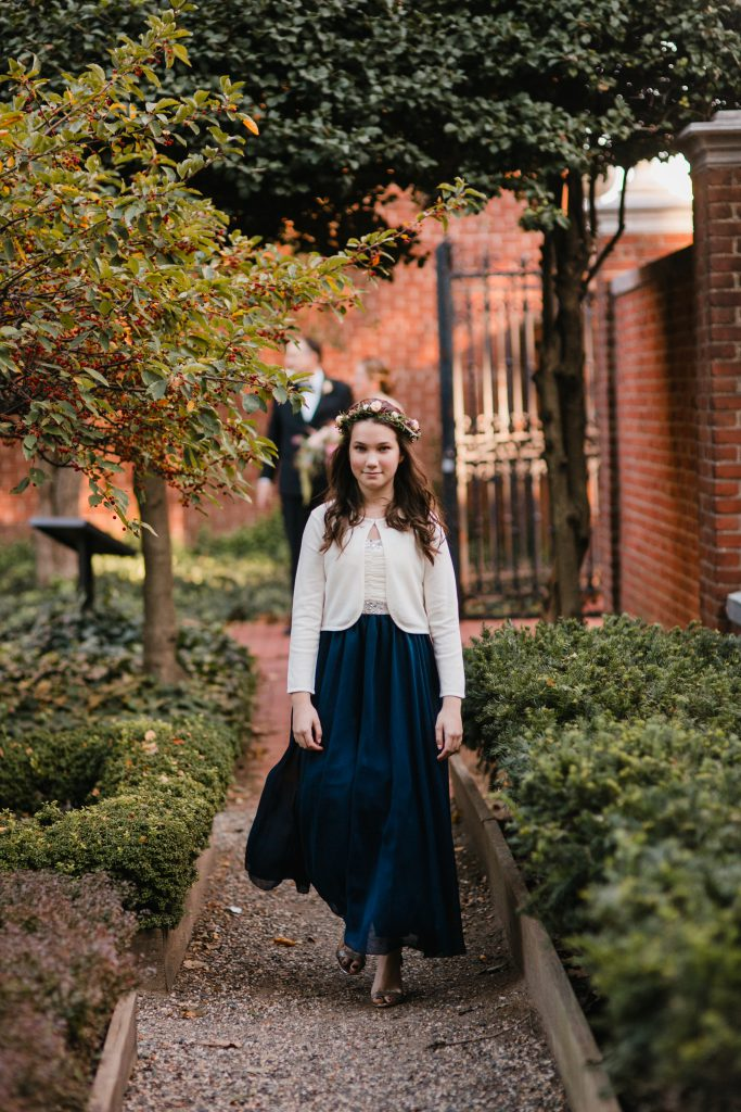 Navy Blue Flower Girl Dress with flower crown for Fall Wedding at 18th Century Garden in Philadelphia. Photo by Love Me Do Photography.