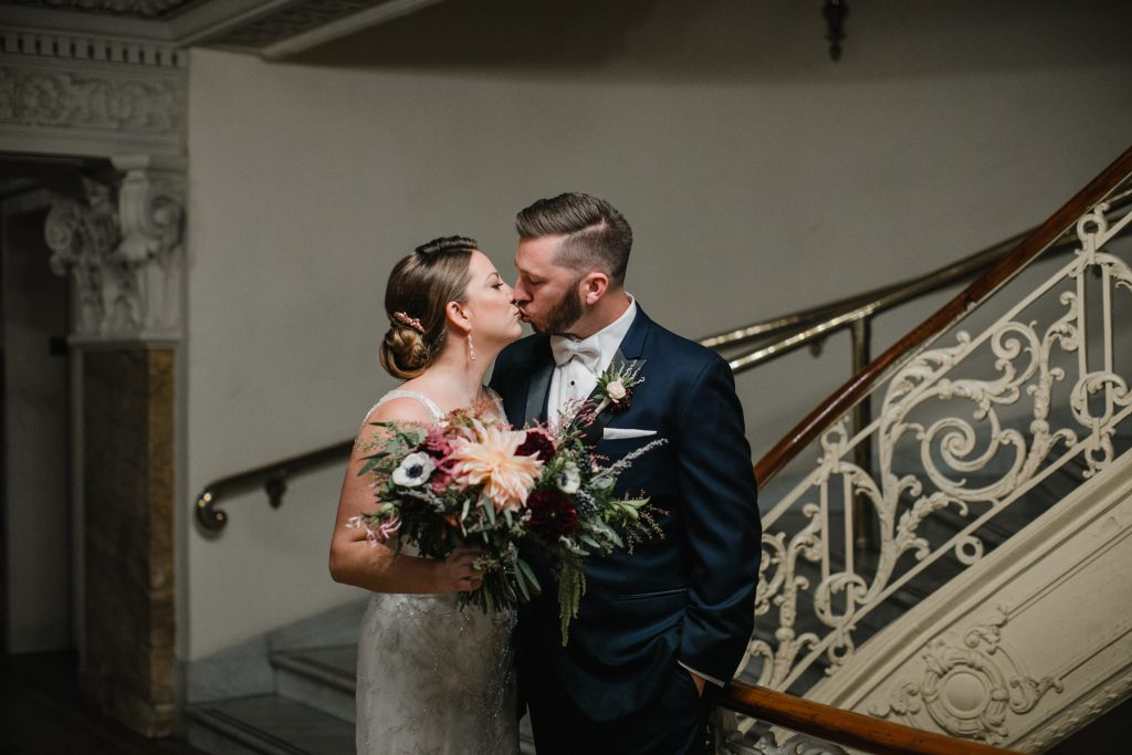 Romantic, flowy, Fall Wedding Bouquet with peach, maroon, white and green flowers. Wedding hair and make-up by Trued Beauty Marks and photo by Love Me Do Photography in Philadelphia.