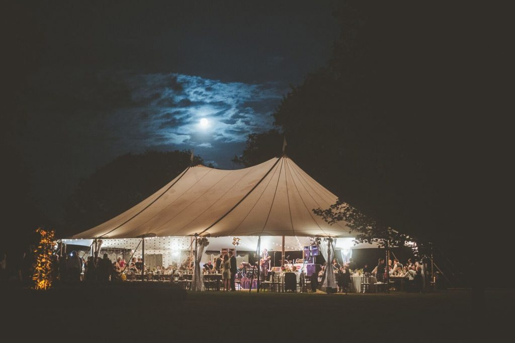 The Inn at Barley Sheaf Farm wedding under white tent at night. Photo by Paper Antler and shared by The Styled Bride.