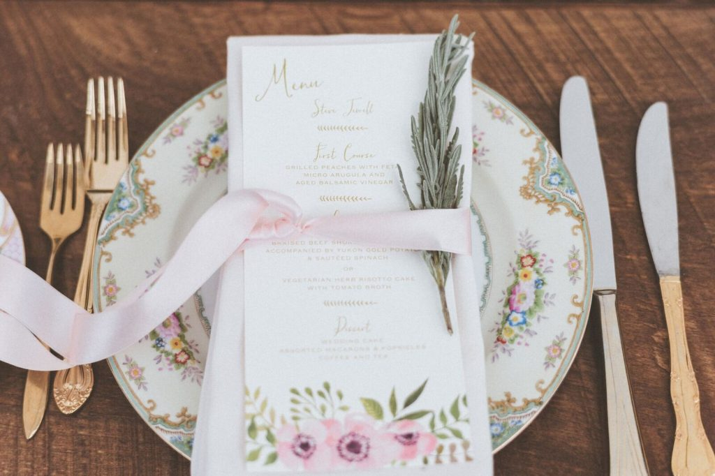 Vintage China Place Setting with Gold Flatware and Custom Menu. Photo by Paper Antler. Shared on Flutter Social by The Styled Bride