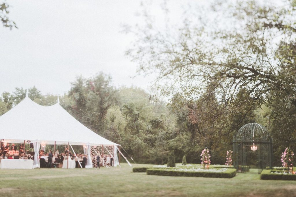 Wedding reception under sailcloth tent at The Inn at Barley Sheaf Farm. Photo by Paper Antler. Shared on Flutter Social by The Styled Bride