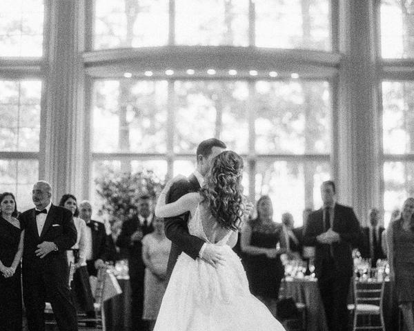 Groom in tux and bride in Monique Lhuillier gown share first dance at Ashford Estate. Photo by Rebecca Yale. Shared on Flutter Social by The Styled Bride