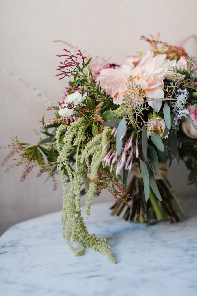 Wild flowy wedding bouquet with pink, green, peach, maroon. Photo by Love Me Do Photography in Philadelphia.