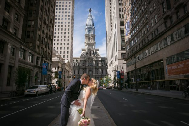 Bride and Groom kiss on Broad St before Philadelphia Country Club Wedding